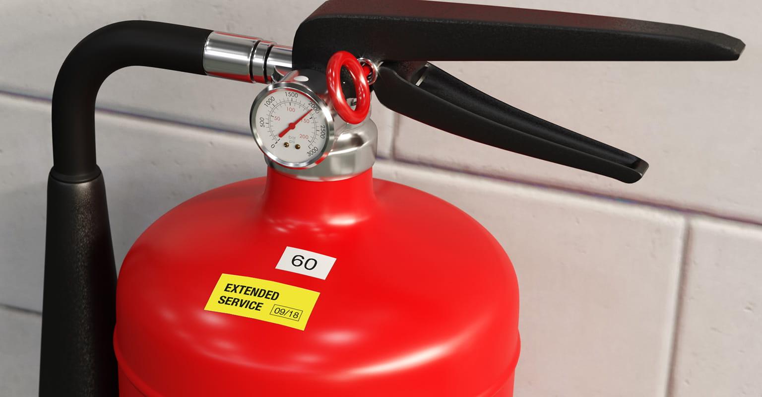 Výstražný štítok na hasiacom prístroji